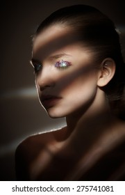 Light and shadows stripes portrait of attractive woman