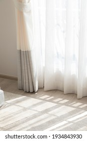 light shine through white curtain by the window of home room.