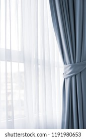 Light shines through curtains in room