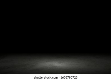 Light shining down on black marble floor in dark room with copy space, abstract background
