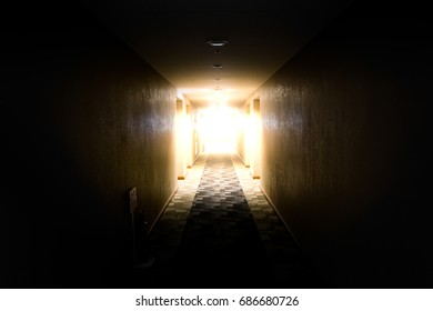 light shining from the end of dark corridor