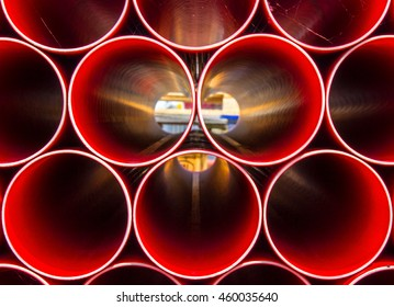 Light shining through Construction pipes all stacked together to create abstract image