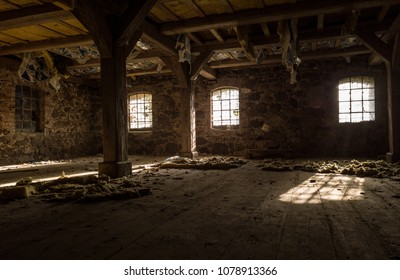 Light shining through windows of very old ruin of a farmhouse.