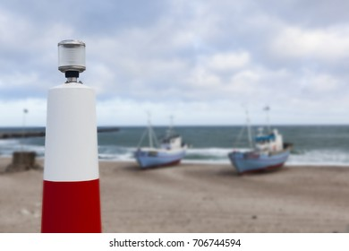 Light signal stand, at the coastline in Denmark