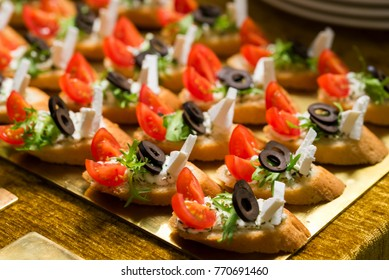 light snacks with olive green cheese and tomatoes