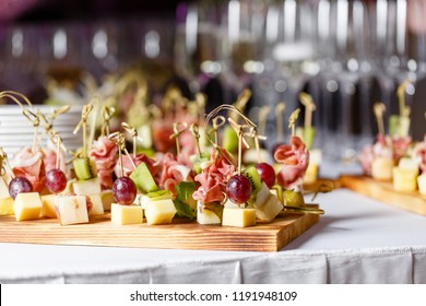 Light snacks in a plate on a buffet table. Assorted mini canapes, delicacies and snacks, restaurant food at event. A gala reception. Decorated delicious table for a party goodies.