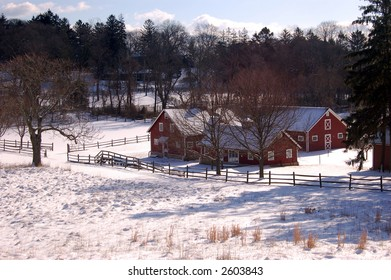 A light snow covers the fields and barn at Huber Woods Park, Middletown, NJ