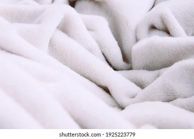 Light soft, fluffy, light blanket. Texture white cotton towel background