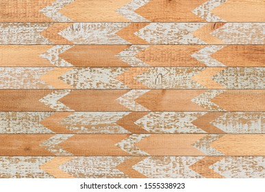 Light spruce parquet floor with geometric pattern. Painted wooden boards texture for background.