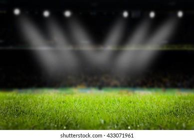 light of stadium or football Stadium, at time Stadium night, stadium light and night stadium lights grass background.