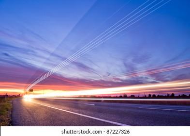 light streaks from long exposure of traffic at sunset