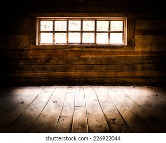 """Light streaming inside window of the Noah """"Bud"""" Ogle Place cabin along the Roaring Fork Motor Nature Trail in Great Smoky Mountains National Park, Tennessee"""