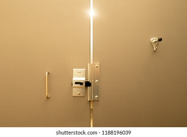 Light streams through the doors in a beautifully designed assmbled and toned bathroom stall