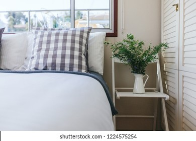 light stylish interior in bedroom of houseboat with green olives
