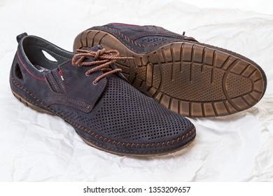 Light summer men's shoes on white paper