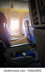 The light of the sun peeking into the window of the plane.