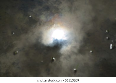 Light of the sun through the thick black clouds
