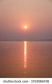 The light of the sunrise in the morning reflected on the water surface.