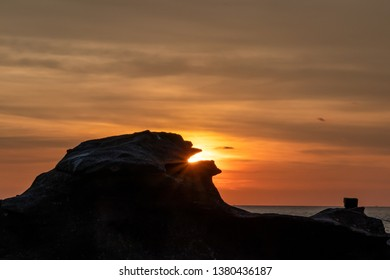 The light in the sunset through the rocks causing shadows at Koh Kood Island.Trat