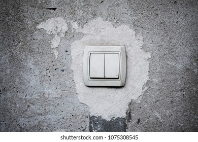 a light switch on the old wall
