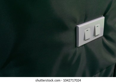 Light switch on the wall.