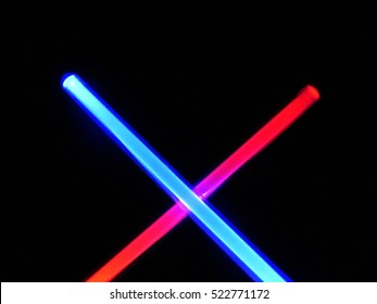 light swords on dark night sky background