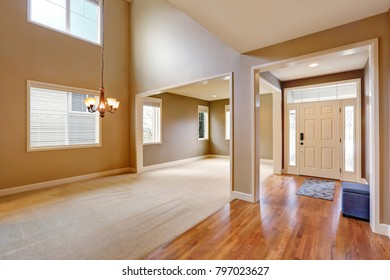 Light taupe interior with amazing floorplan. Photo of 2 story formal dining room with adjoining formal living room. Northwest, USA