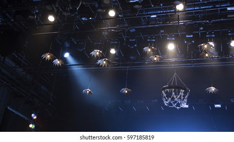 Light theatrical spotlights above the stage and on the console