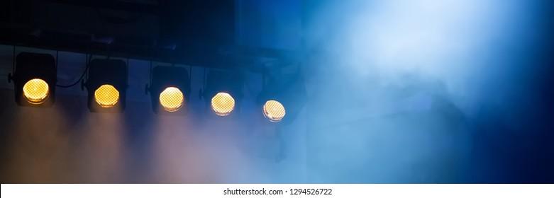 light theatrical spotlights. Lighting concert performance. Banner for design.