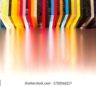 light through Stack of different colours Cast Acrylic Sheet on white background