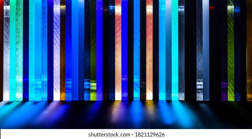 light through Stack of different colours Cast Acrylic Sheet on black background
