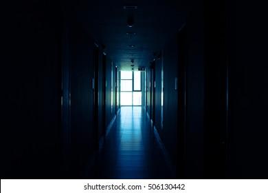 Light through window at Corridor in empty condominium, perspective