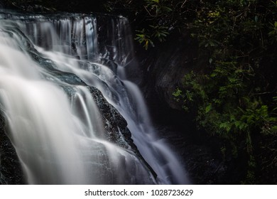 Light touches the top of the falls at White Owl Falls in NC