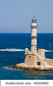 Light tower marking the entrance to Chania harbor in Crete, Greece