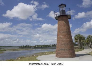 Light tower on lake/Kissimmee Lighthouse/Historical navigational aid