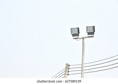 Light towers with spotlights and powerlines