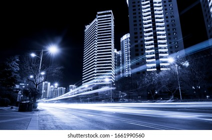 The light trace of the background of modern urban architecture w