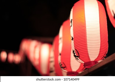 Light up traditional red and white Japanese rice paper balloons with unidentified characters at a festival in Tokyo, Japan