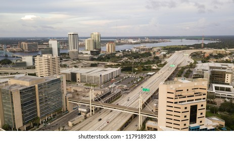 Light traffic exists before sunset in Jacksonville, Florida in this aerial view with St Johns River