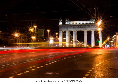Light trail by cars at night and the Moskovskiye Vorota (Moscow Triumphal Gate, St Petersburg), Russia