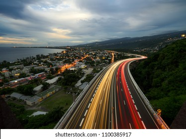 Light trail of cars on the tamarin road in Saint Paul, Reunion Island
