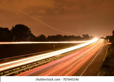 Light trail formed by number of car headlight on arlington VA 123 route