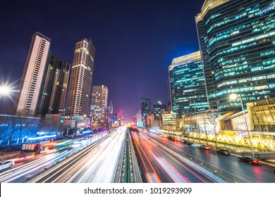 light trail with modern building background in beijing china.