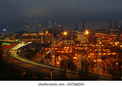 Light trail shot of the Tsing Kwai Highway and the Kwai Tsing Container Terminals in Hong Kong
