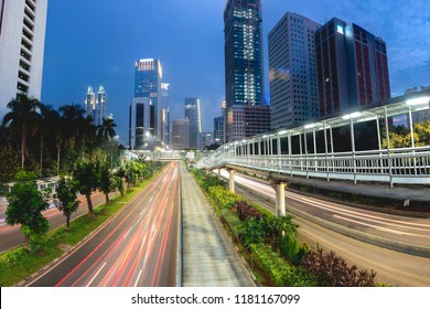 Light trail of vehicle traffic in Jakarta main road, Sudirman Street,  Jakarta. Also showing row of beautiful skyscrapper in the side of the road. Urban Skyline, Building Exterior, Capital Cities