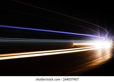 Light traillight trails in tunnel. Art image. Long exposure photo taken in a tunnel.