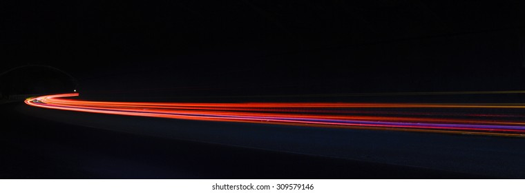 Light trails. Art image. Long exposure photo taken in a tunnel.