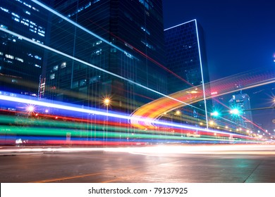 light trails with blurred colors on the street at night