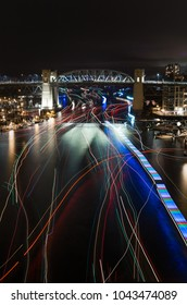 Light trails from boats near English Bay, Vancouver, returning from the fireworks display, Celebration of Light.