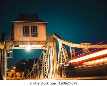 Light trails of a car driving over a bridge at night in Cologne, Germany.